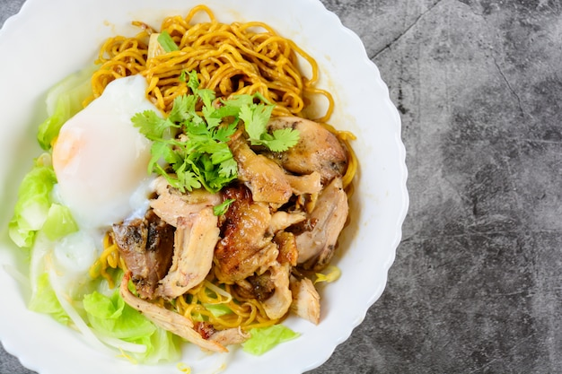 Egg noodles served dry with roasted honey chicken and soft boiled eggs (onsen tamago eggs)
