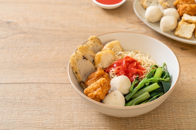 Egg noodles with fish balls and shrimp balls in pink sauce, yen ta four or yen ta fo - asian food style
