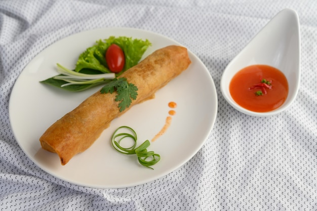 Egg roll or fried spring rolls on the white plate thai food. .