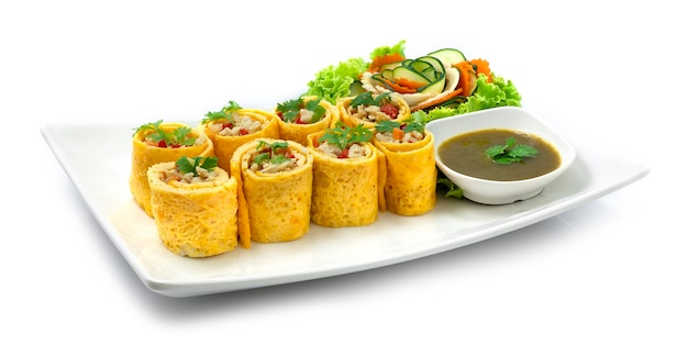 Egg roll stuffed with chickencarrotsonion and chili served chili sauce cooked