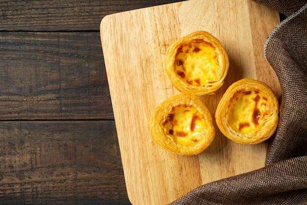 Egg tart on wood.