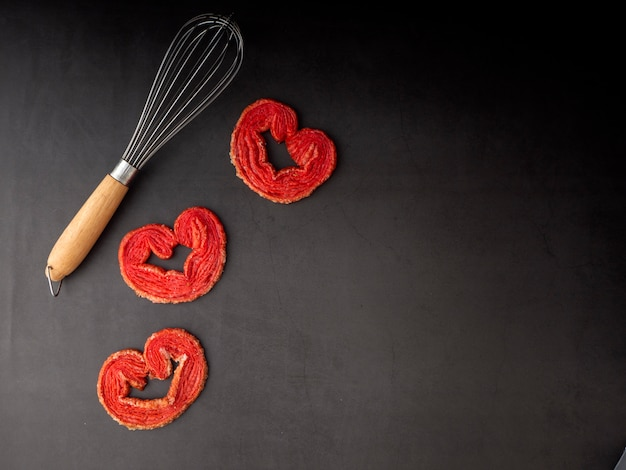 Egg whisk with strawberry puff heart
