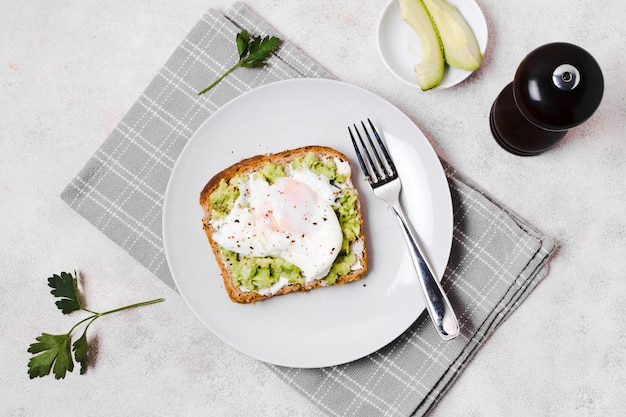 Egg with avocado toast on plate