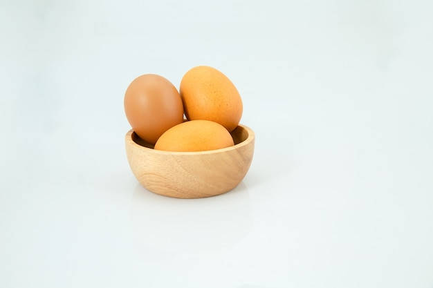 Egg on wooden spoon