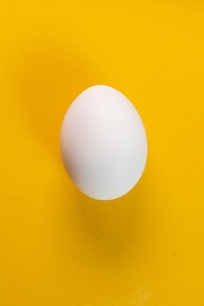 Egg on the yellow background