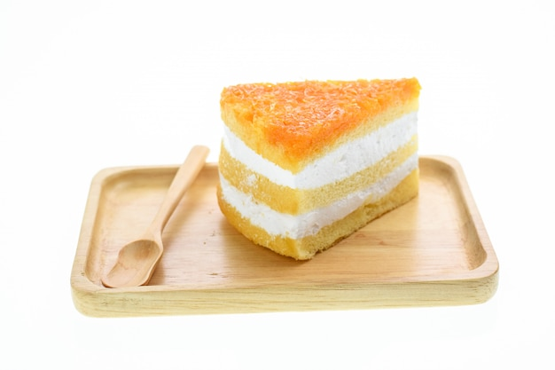 Egg yolk thread cakes stuffed with cream on a white background