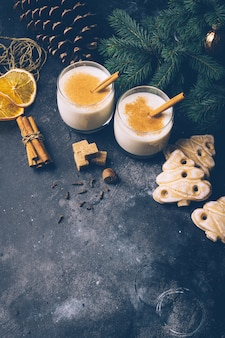 Eggnog (egg-nog), traditional christmas winter drink with cinnamon, cloves and nutmeg. homemade drinks. winter christmas mood. copyspace.