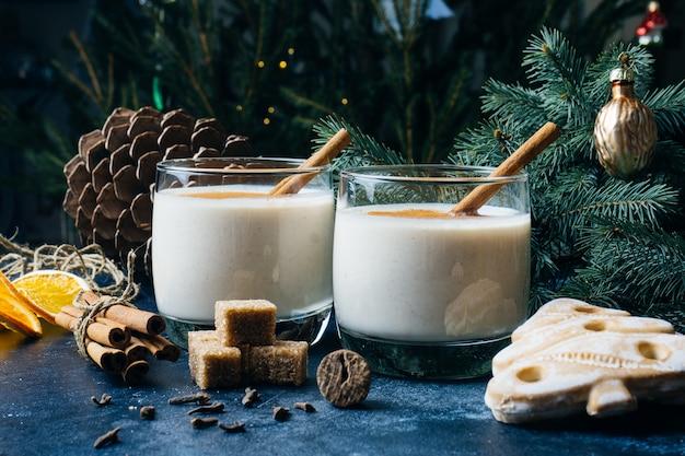 Eggnog (egg-nog), traditional christmas winter drink with cinnamon, cloves and nutmeg. homemade drinks. winter christmas mood.