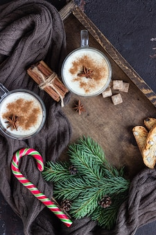 Eggnog with cinnamon, served in two glass mugs