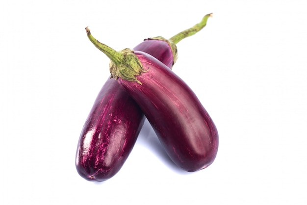 Eggplant or aubergine or brinjal vegetable isolated on a white wall.