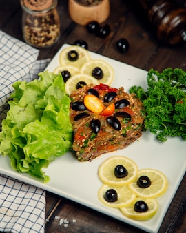 Eggplant caviar and lemon topped with olives