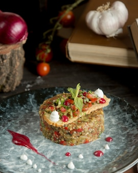 Eggplant caviar with finely chopped vegetables