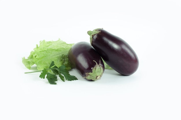 Eggplant, lettuce and parsley on a white background.