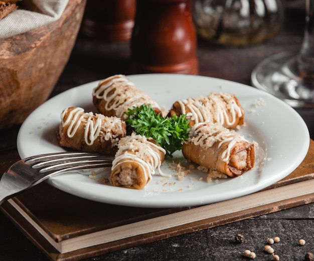 Eggplant rolls with nuts garlic and mayonnaise