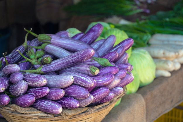 Eggplants on the counter of a vegetable store.