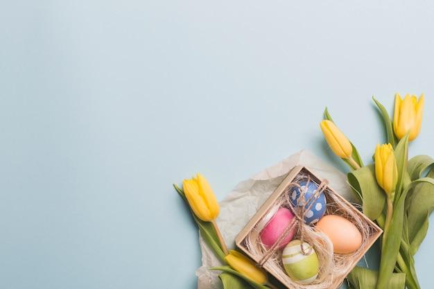 Eggs amidst tulips
