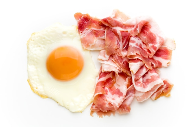 Eggs and bacon on the isolated surface.