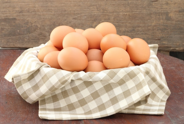 Eggs in basket, close up.