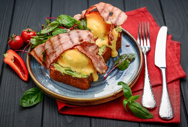 Eggs benedict- toasted , bacon, poached eggs, and delicious buttery hollandaise sauce. a restaurant