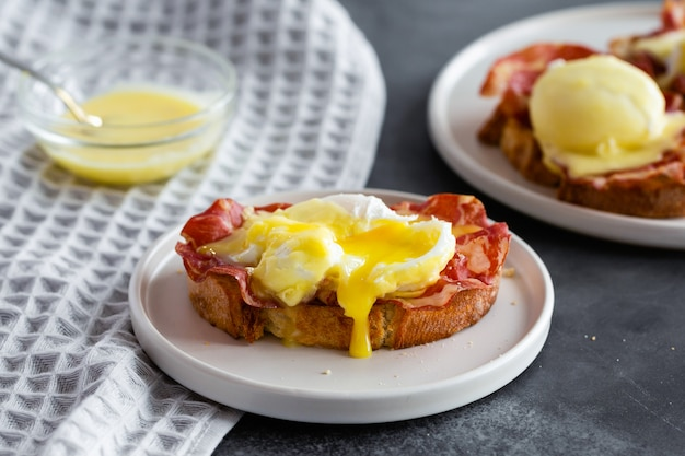 Eggs benedict- toasted english bread, parm ham, poached eggs with hollandaise sauce and lemon on gray