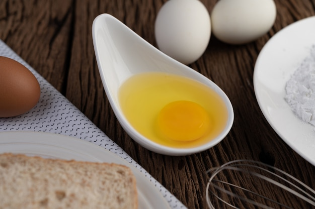 Eggs, bread, tapioca flour and an egg beater, ingredients used in bakery