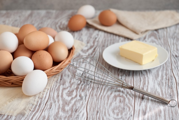 Eggs, butter and whisk, shallow depth of field