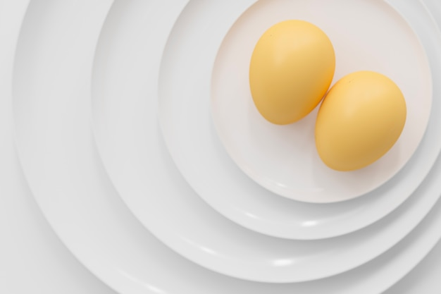 Eggs on many plates stacked together.
