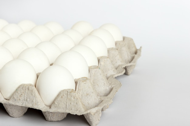 Eggs in the package, white eggs in pack on white background