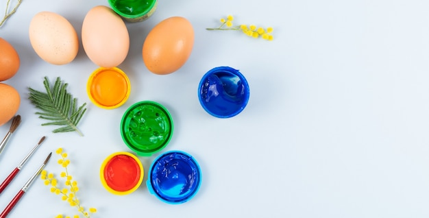 Eggs and paints. easter eggs decoration process. copy space. top view.