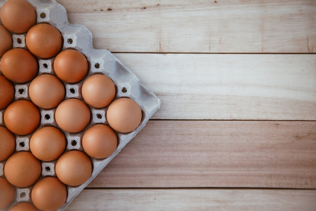 Eggs in paper boxes placed on wooden floors