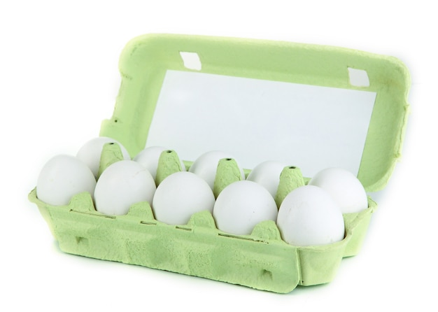 Eggs in paper tray on white