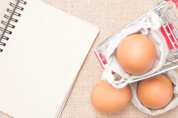 Eggs in red cart with brown paper blank