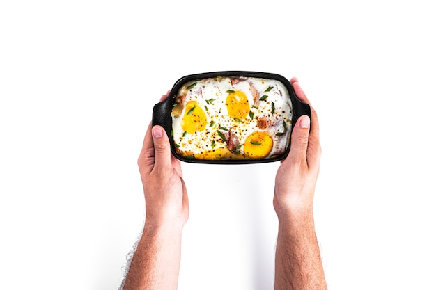 Eggs with bacon isolated on a white background. baked scrambled eggs. high quality photo