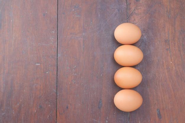 Eggs on wood floor.