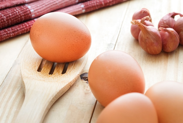 Eggs on wooden table with selective focus