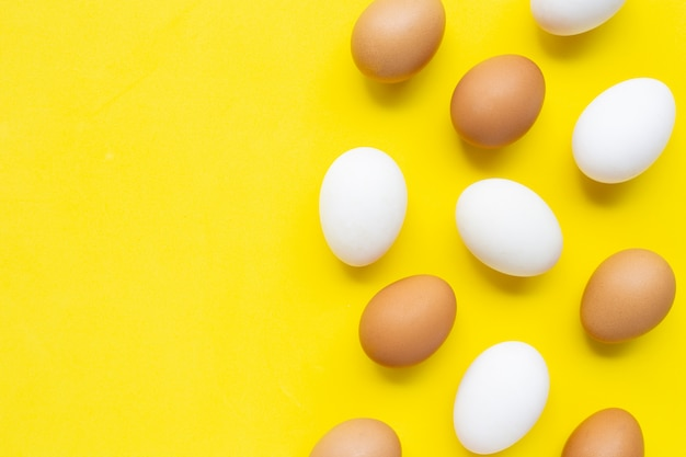 Eggs on yellow background.