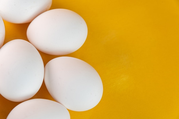 Eggs on the yellow background
