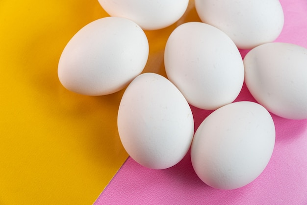 Eggs on the yellow and pink table