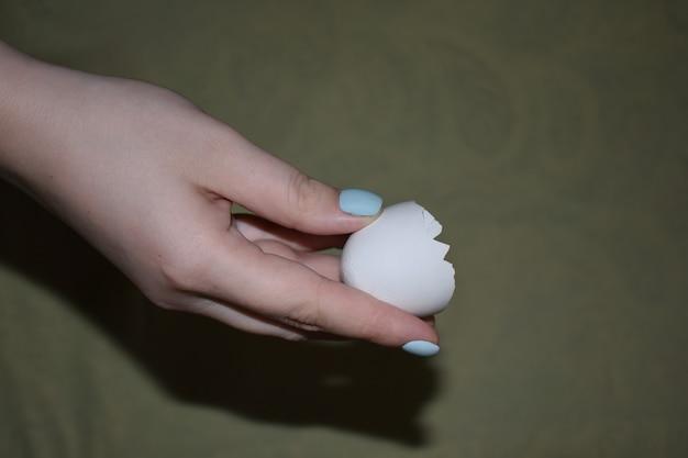 Eggshells in a woman's hand