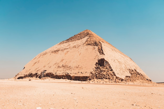 Egypt. dahshur or dashur. the bent pyramid also knew as false, or rhomboidal pyramid because of it changed angle slope of pharaoh sneferu with well preserved original limestone casing