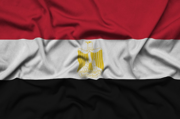Egypt flag is depicted on a sports cloth fabric with many folds.