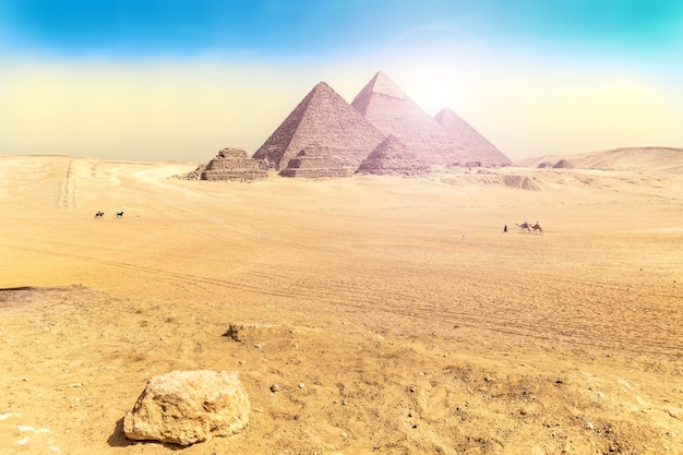 Egyptian desert scenery with the great pyramids of  giza.