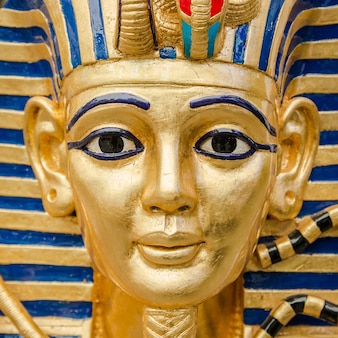 Egyptian golden pharaohs mask - travel to egypt concept , egyptian casket