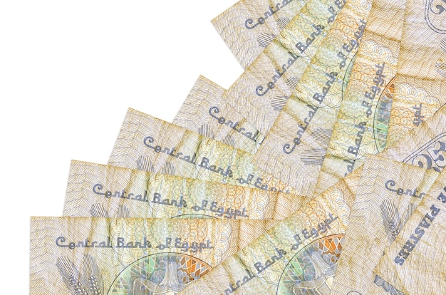 Egyptian piastres bills laying in different order on white surface
