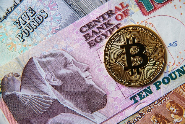 Egyptian pounds banknotes and cryptocurrency coins. cryptocurrency investment concept. crypto mining or trading