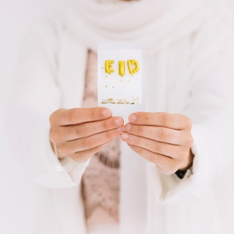 Eid al-fitr concept with hands showing card