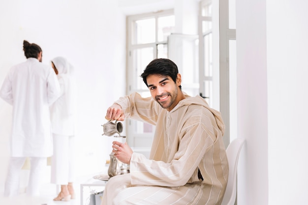 eid-al-fitr-concept-with-man-and-tea_23-2147799523.jpg