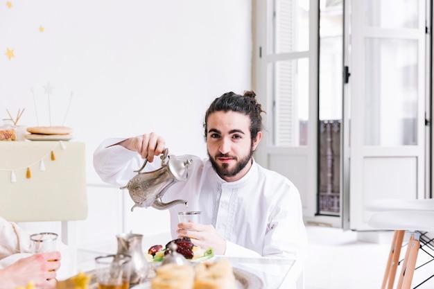 Eid al-fitr concept with man and tea