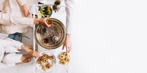 Eid al-fitr concept with tea and copyspace