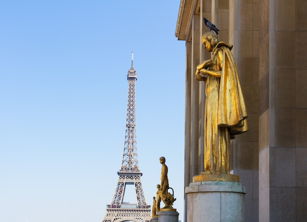 Eiffel tour and statues of trocadero garden, dating from the 1930s, copy space on sky, paris,  france